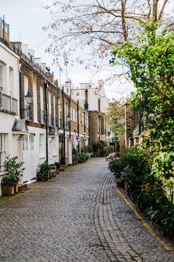 A crowded street in London lined with homes for sale